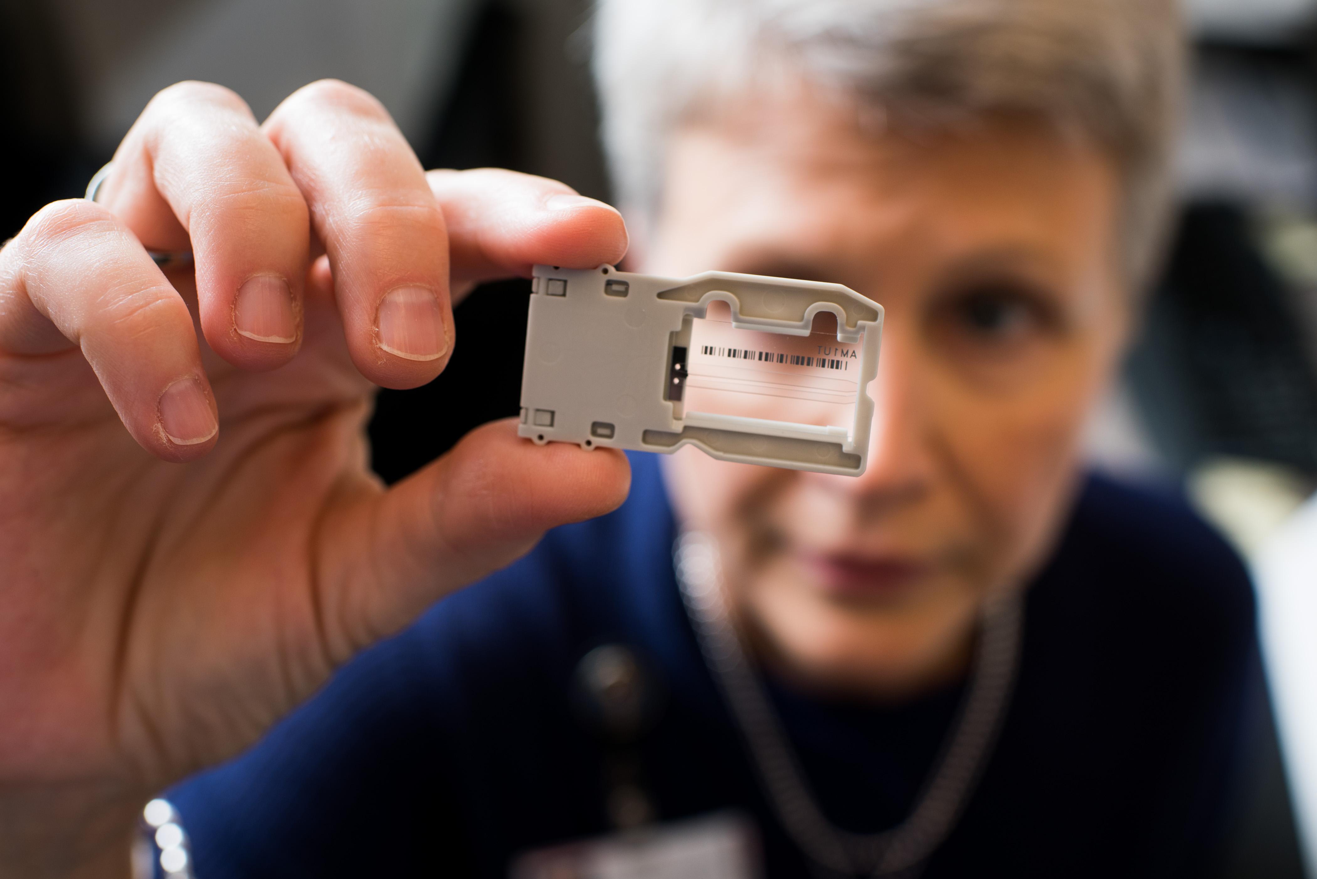 Debra Leonard looking at a Covid-19 lab test