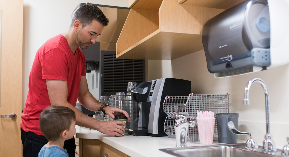 Father and son making coffee in Mother Baby Unit kitchen