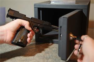 Putting a gun in a safe lock box
