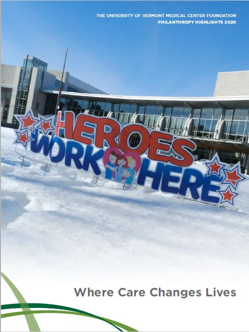 """Newsletter cover image of the front of UVM MC Medical Center with a sign that says """"Heroes work here""""."""