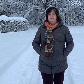 Woman standing outside in the snow