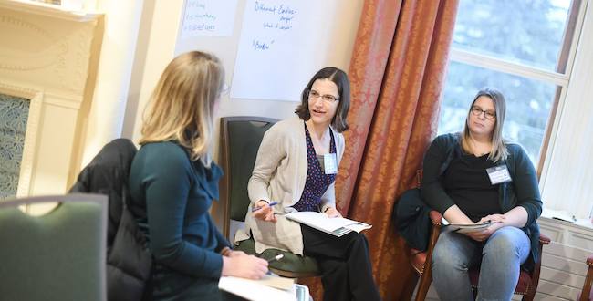 Three female Hospice & Palliative Care fellows in a groups discussion.