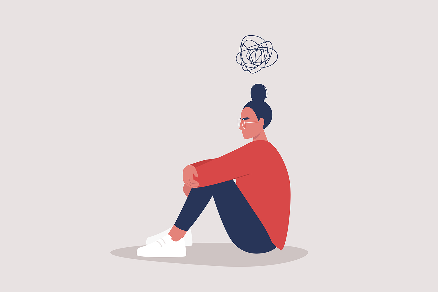 An illustration of young female sitting on the floor and holding their knees with a scribble thought bubble above her head.