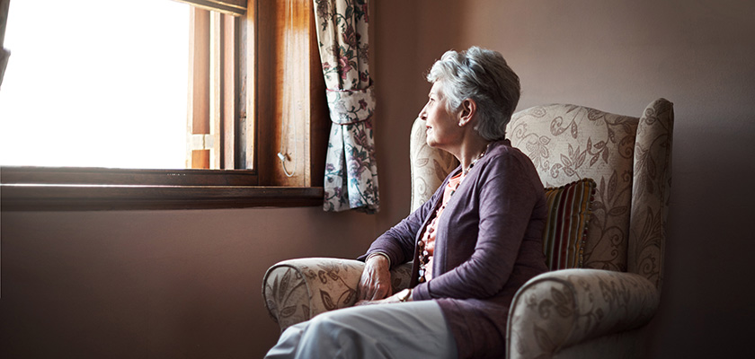 Older woman staring out window