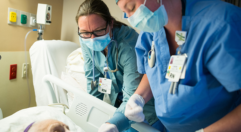 Nurses taking care of a patient