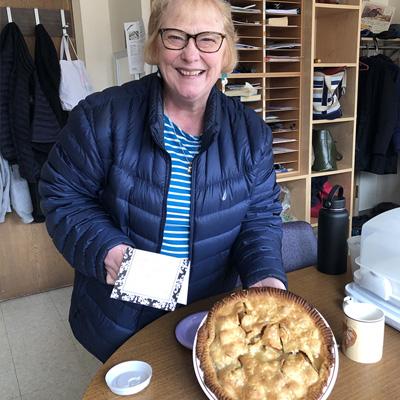 Volunteer donating pie to UVM Medical Center staff