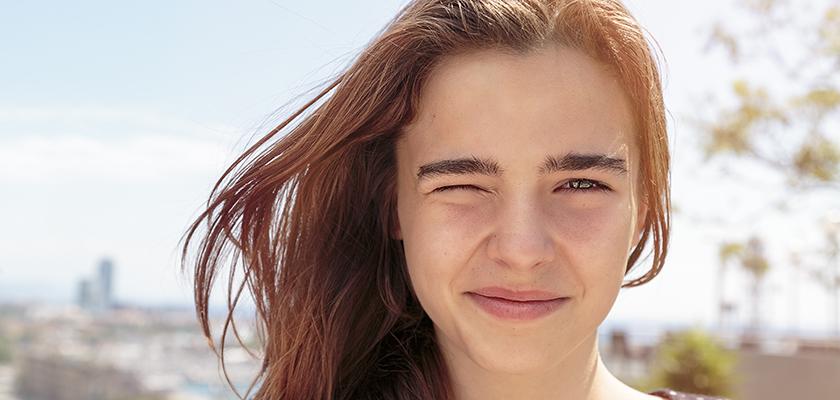 Female teen winking
