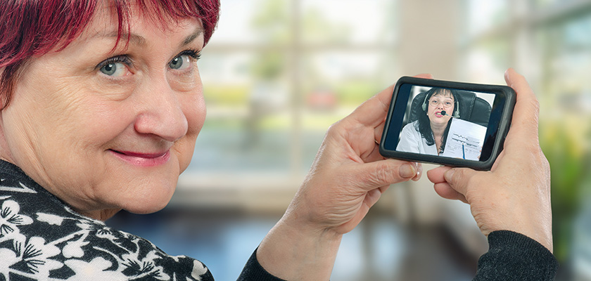 Woman speaking with health care provider through mobile device