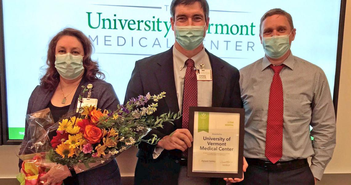 Dr. Leffler, standing with two staff members, of UVM Medical Center holding the 5 Star Award for Patient Safety.
