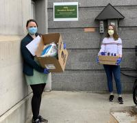 Larner School of Medicine students holding boxes of PPE donations