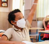Children in classroom wearing masks