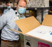 UVMMC Wes McMillian, Director of Pharmacy Services, verifies the successful delivery of the Pfizer COVID-19 vaccine