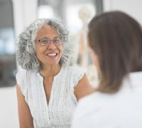 Woman interacting with provider
