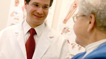 Physician talking senior patient.