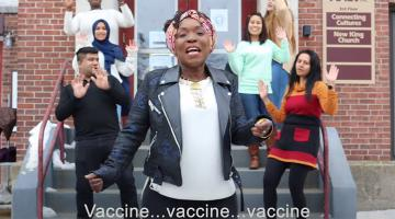 Screenshot of a music video related to the COVID-19 vaccine.