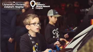 UVMMC Children's Hospital Extra Life promo Image featuring two young boys playing arcade games.