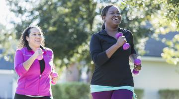 2 women walking for exercise.